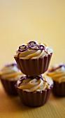 Four chocolate and caramel pralines (close-up)