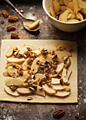 Puff pastry topped with apples and pecan nuts