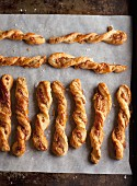Tangy cheese straws on a baking tray