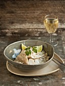 Poached fillet of fish on rice with a glass of white wine