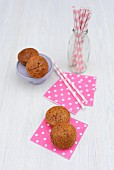 Banana muffins with chocolate, paper napkins and drinking straws