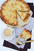 Pear tart with chocolate and a cup of coffee