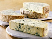 Several half moons of Stilton on marble boards