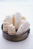Meringues in an old cake tin
