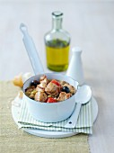 A stew with turkey breast, tomatoes and olives