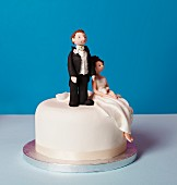 A small wedding cake with a bridal couple