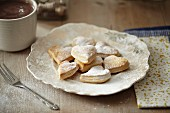 Puff pastry hearts with icing sugar for Christmas