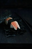 Nigiri sushi with crab between sheets of salty nori (Japan)