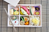 Bento box with fish, tempura, rice etc. (Japan)