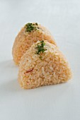 Onigiri (spiced rice balls, Japan) with peppers and salmon