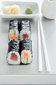 Maki sushi with tuna, salmon and cucumber