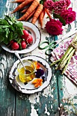 Honey, vegetables and flowers on a weathered garden table