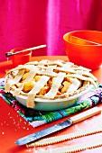 Peach pie in a pie dish