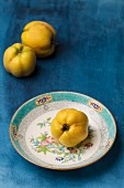 Quinces on a plate and to one side