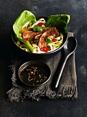 Noodle soup with beef and pak choi (Vietnam)