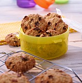Oat and raisin cookies in a Tupperware pot