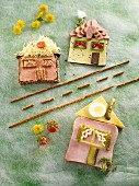 Wholemeal bread houses with ham, cheese and pickled gherkins