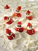 Strawberry Father Christmases on meringue snow