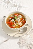 Christmassy vegetable soup with cod