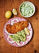 Wiener Schnitzel (breaded veal escalope from Vienna) with potatoes and cucumber salad