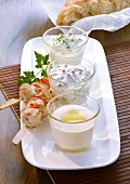 Lime dip, cucumber dip and cream cheese & herb dip served with chicken skewers