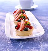 Creamy quark dessert with berries in pastry cases