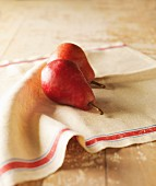 Two Red Pears on a Linen Towel