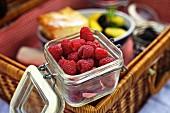 Fresh raspberries on a picnic basket