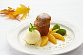 Nut soufflé with pear wedges and vanilla ice cream