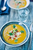 Squash soup with coconut, sliced chillies and coriander (Asia)