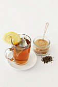 Peppermint tea with tea leaves and lemon