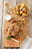 Lemon chicken with thyme and garlic potatoes