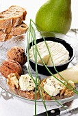 Slices of bread topped with goat's cheese, pears and nuts