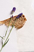 A slice of bread and lavender flowers