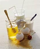 A still life of foodstuffs featuring honey, milk, yoghurt, eggs and brown sugar