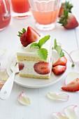 A piece of strawberry cream cake