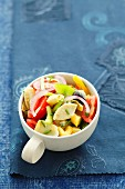 Vegetable salad with artichoke hearts, peppers, tomatoes and onions
