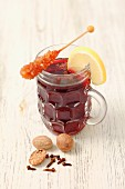 Red mulled wine with nutmeg and a rock sugar swizzle