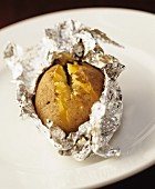A baked potato in aluminium foil