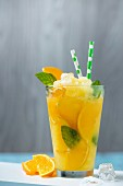 Orange granita with mint and orange slices