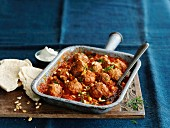 Meatballs with tomato sauce, pine nuts and flatbread (Turkey)