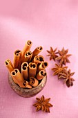 Cinnamon sticks in a bowl, with star anise to the side