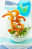 Deep-fried prawn skewers with rocket and fennel