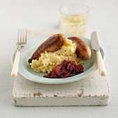 Bratwurst with mashed potatoes and onion relish