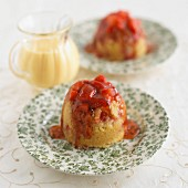 Steamed pudding with strawberries and vanilla sauce