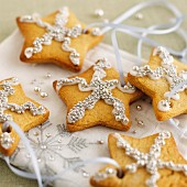 Gingerbread stars with silver pearls as Christmas ornaments