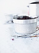 Elderberries in a colander insert