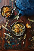 dried marigold, lime flowers and a cast iron tea pot