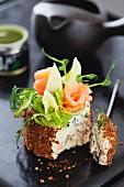 Mini cream cheese cake with rye bread, smoked salmon and wasabi
