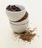 Caraway and juniper berries in small bowls